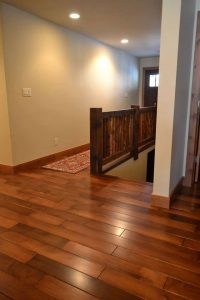 Hand Scraped Custom Stained Hard Maple Flooring with Reclaimed Timber Railing