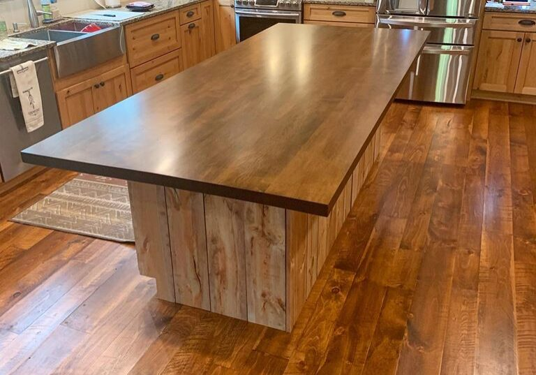 White Pine Tongue and Groove Endmatch Square Edge Flooring Stained with custom hard maple island top